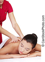 Pretty woman relaxing being massaged