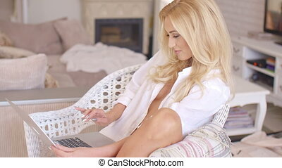 Pretty woman relaxing in a wicker chair