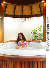 Pretty woman relaxing in jacuzzi