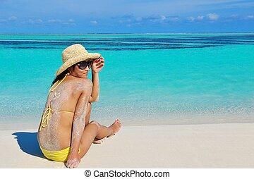 pretty woman resting on tropical  beach