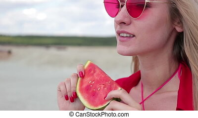 Pretty woman seductively eating watermelon - Charming woman...