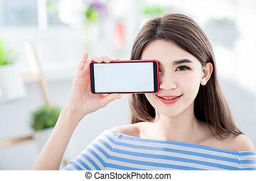 Pretty woman show her smartphone - Pretty woman show her ...