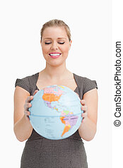 Pretty woman showing a globe