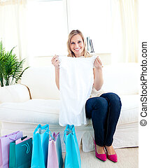 pretty woman showing her shopping