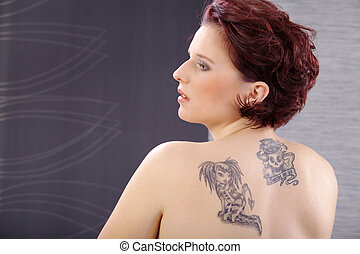 pretty woman showing tattoo