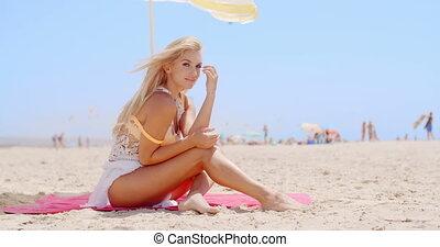 Pretty Woman Sitting at the Beach Under Umbrella