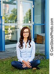 Pretty woman sitting crosslegged