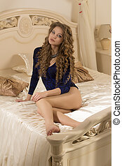 Pretty woman sitting on a bed