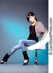 pretty woman sitting on chair ring