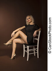 pretty woman sitting on chair
