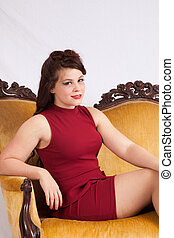 Pretty woman sitting on couch