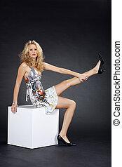 pretty woman sitting on cube
