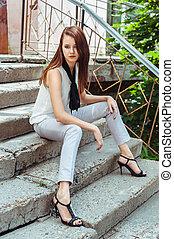 Pretty Woman Sitting on Steps