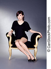 pretty woman sitting on stool