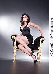 pretty woman sitting on stool