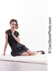 Pretty woman sitting on white background