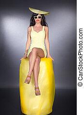 pretty woman sitting on yellow roll