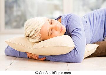 Pretty woman sleeping on the floor - Photo of a pretty woman...