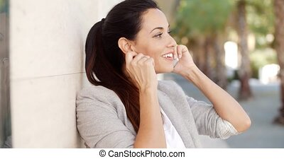 Pretty woman smiling as she chats on a mobile