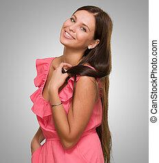 Pretty woman smiling wearing a pink dress