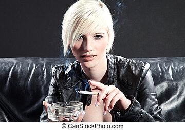 pretty woman smokes cigarette