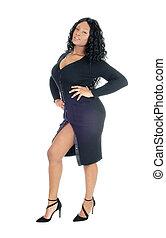 Pretty woman standing in black dress.