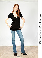 Pretty woman standing in jeans