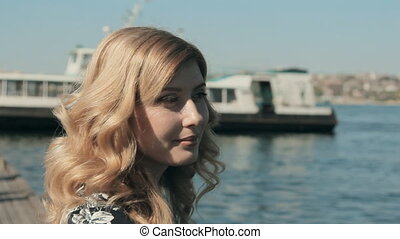 Pretty woman standing near water at the berth - Close up of...
