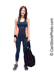 Pretty woman standing with sports bag