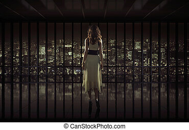 Pretty woman staring at night city - Beautiful woman staring...