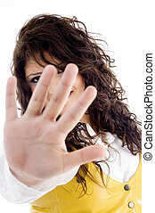 pretty woman stopping someone with open palm