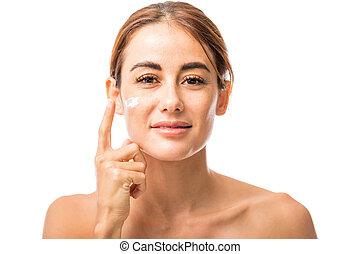Pretty Woman Taking Care Of Facial Skin