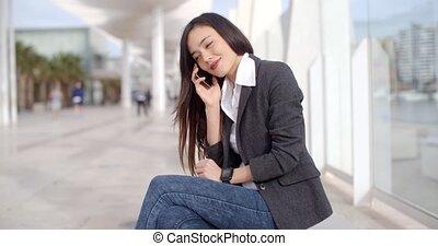 Pretty woman talking on a mobile