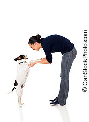pretty woman training a pet dog isolated on white background...
