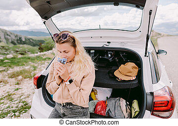 pretty woman travel by car in mountains on road trip vacation