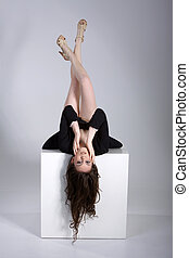 pretty woman upside down on cube