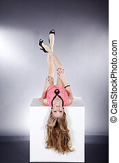 pretty woman upside down on cubes
