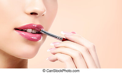 Pretty woman uses cosmetic makeup brush