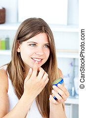 Pretty woman using vaseline for her lips - Pretty woman ...