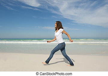 Pretty woman walking exercise beach