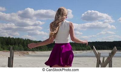Pretty woman walking in silk skirt opening buttocks - Back...