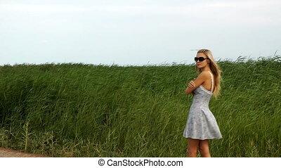 pretty woman walking  reed