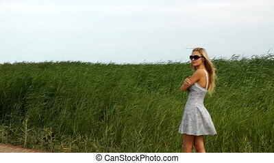 pretty woman walking  reed