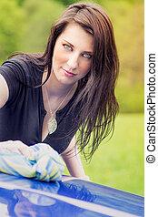 Pretty woman washing her car