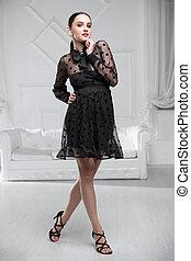 Pretty woman wearing ?black dress