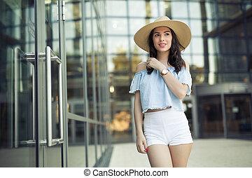 Pretty woman wearing hat