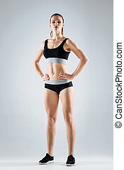 Pretty woman wearing sportswear - Active life. Slim young...