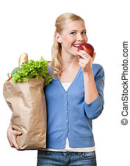 Pretty woman with a bag full of healthy food - Pretty woman...