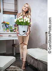 Pretty woman with a bouquet in hands
