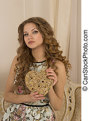 Pretty woman with a decorative heart